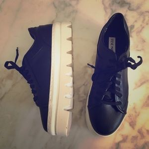 Black-and-white Steve Madden lace-up sneakers